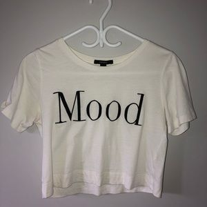 "White cropped ""mood"" t-shirt."
